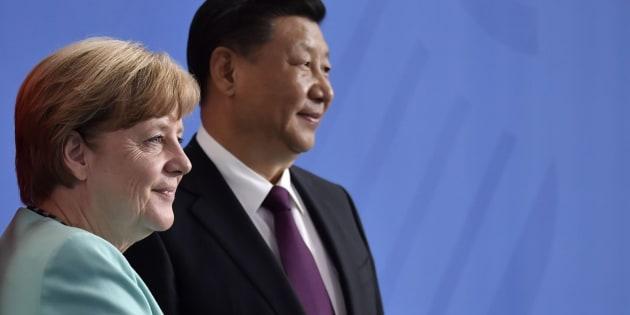 La canciller Angela Merkel y el presidente chino, Xi Jinping.