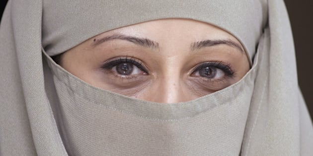 Farhat Mirza, vice president of the Council for the Advancement of Muslim Professionals in Montreal, poses with her niqab March 24, 2007 in Montreal.