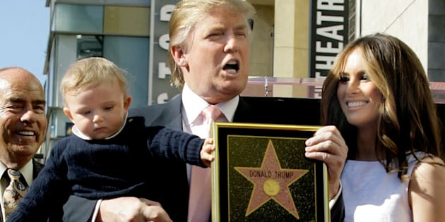 ADVANCE FOR WEDNESDAY, JULY 13, 2016, AT 12:01 A.M. EDT AND THEREAFTER - FILE - In this Jan. 16, 2007 file photo, Donald Trump, with his wife, Melania Trump, and their son, Barron, pose for a photo after he was honored with a star on the Hollywood Walk of Fame in Los Angeles. (AP Photo/Damian Dovarganes, File)