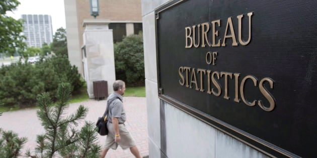 An employee makes their way to work at Statistics Canada, in Ottawa on July 21, 2010.