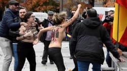 Manifestantes franquistas intentan agredir a tres activistas de FEMEN que protestaron contra la