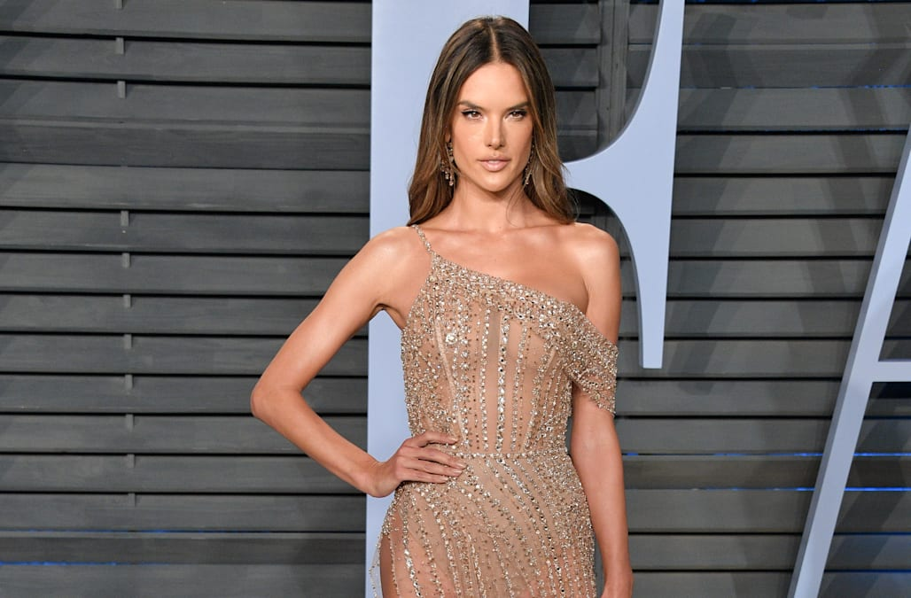6076c7f14f0 Vanity Fair Oscars Party 2018  Alessandra Ambrosio wows in nearly-nude  crystal gown