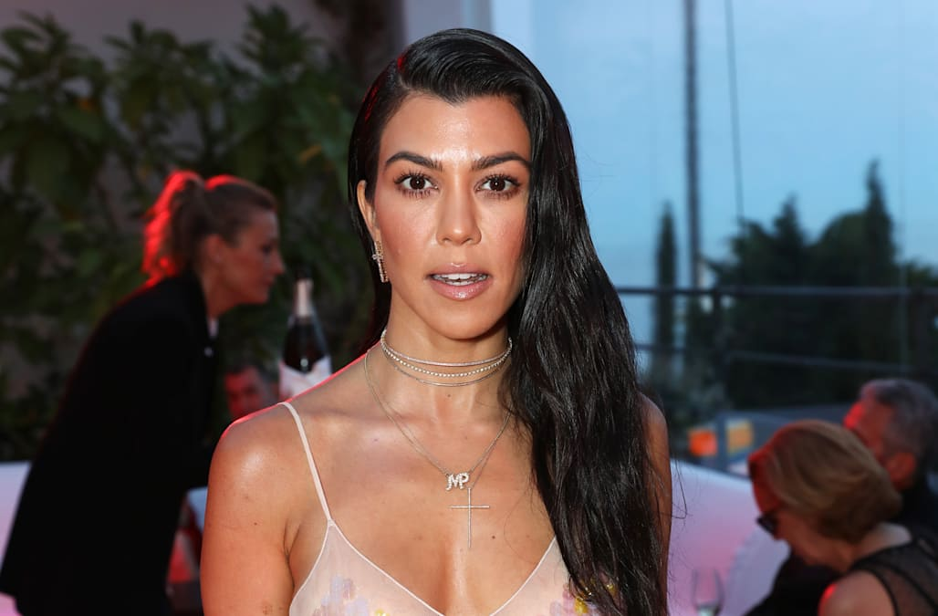 64dce45eeec Kourtney Kardashian hits Miami Beach in high-waisted white swimsuit ...