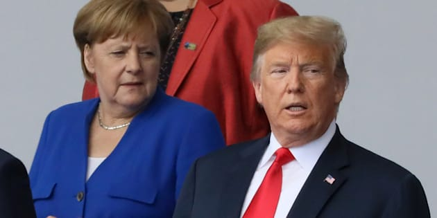 German Chancellor Angela Merkel and U.S. President Donald Trump are seen as they pose for a family photo at the start of the NATO summit in Brussels, Belgium on July 11, 2018.