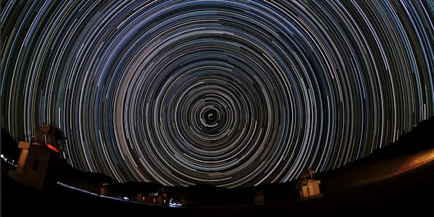 Nearly a complete night (about 8 hours) of Indian Himalayas is captured in this polar star trail image looking toward the north celestial pole. In the foreground the High Altitude Gamma Ray Telescope Array, located at an altitude of 4270 metres near Hanle in Ladakh.