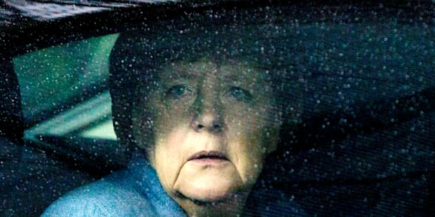 German Chancellor Angela Merkel waits in her car as she arrives to attend the Eastern Partnership summit at the European Council Headquarters in Brussels, Belgium, November 24, 2017.    REUTERS/Virginia Mayo/Pool