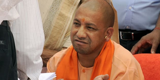 Uttar Pradesh Chief Minister Yogi Adityanath talking to LDA officials during the inspection of Gomti River Front.