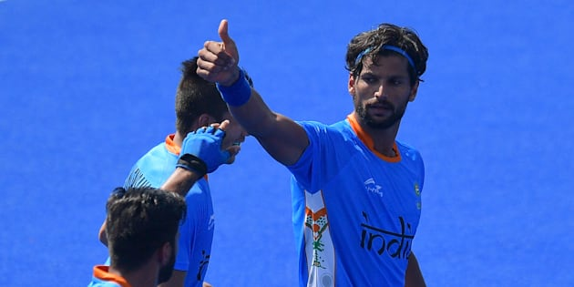 India's Rupinder Pal Singh (R) celebrates scoring a goal during the men's field hockey India vs Ireland match of the Rio 2016 Olympics.
