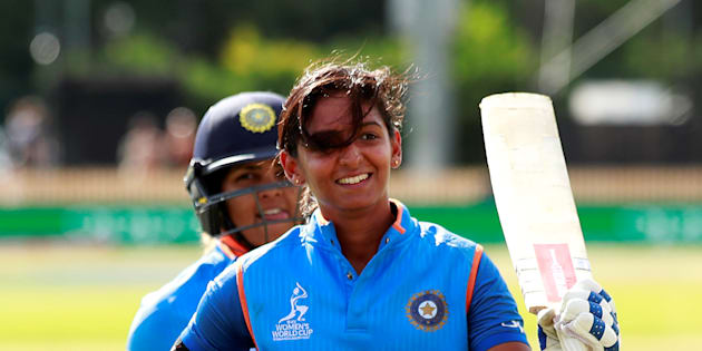 India's Harmanpreet Kaur walks off after scoring 171 not out.