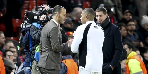 Kylian Mbappé au micro du journaliste Mohamed Bouhafsi de RMC Sport avant Manchester United-PSG le 13 février 2019.