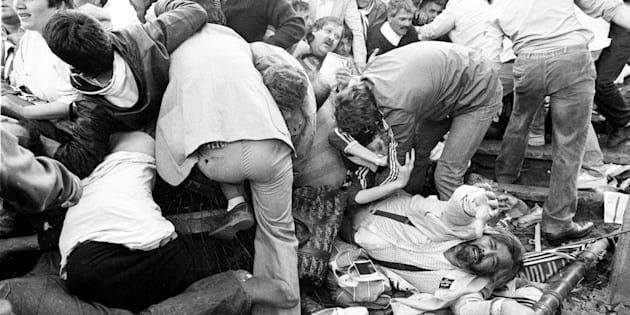 FILE PHOTO 29MAY85 - Juventus soccer fans struggle to get free from a crush after a wall collapsed during riots before the European Cup final between Juventus and Liverpool May 29 1985 at the Heysel stadium in Brussels. Nearly fifteen years after one of the worst disasters in European soccer history, Brussels' soccer stadium, now re-named The King Baudouin stadium, will host games that are part of a showpiece event, this summer's European Soccer championships hosted jointly by Belgium and The Netherlands.  AC