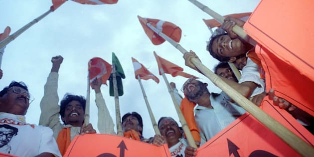 Supporters of the Shiv Sena party brandish their bow and arrow symbols at an election rally in Mumbai.