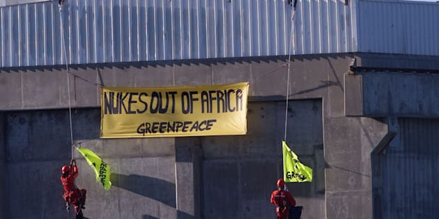 Greenpeace activists protest on a roof at the Koeberg Nuclear Power station near Cape Town, August 24, 2002.