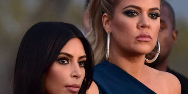 US reality TV star Kim Kardashian (L) and her sister Khloe visit the genocide memorial, which commemorates the 1915 mass killing of Armenians in the Ottoman Empire, in Yerevan on April 10, 2015. AFP PHOTO / KAREN MINASYAN        (Photo credit should read KAREN MINASYAN/AFP/Getty Images)