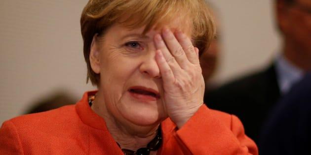 German Chancellor Angela Merkel gestures at a CDU/CSU parliamentary group meeting at the Bundestag in Berlin, Germany, November 20, 2017. REUTERS/Axel Schmidt