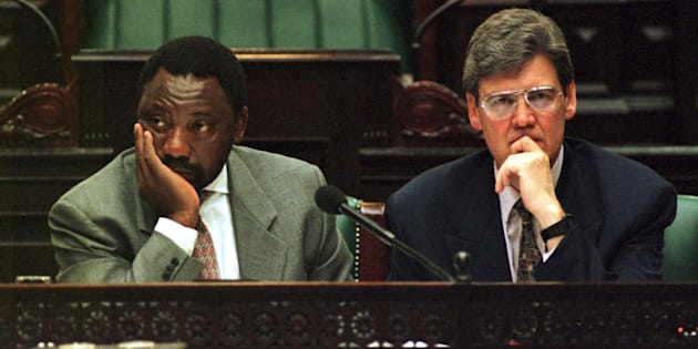 A tired Constitutional Assembly chairperson Cyril Ramaphosa (L) and deputy chairperson Leon Wessels (R) listen to submissions as they work on into the night in an effort to break the deadlocks on South Africa's new Constitution.