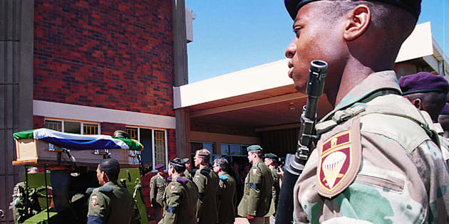 Soldiers from the Tempe Military Base in Bloemfontein stand guard at the funeral of Major Jaques Coetzer, September 21.