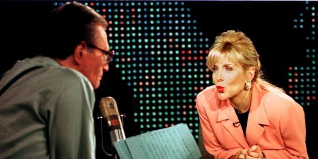 Gennifer Flowers blows a kiss to Larry King during an interview. Former President Bill Clinton admitted to having an affair with Flowers whilehe was governor of Arkansas.