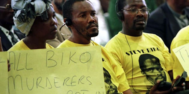 Demonstrators protest against five former security policemen's application for amnesty at the Truth and Reconciliation Commission, in 1997; the policemen were applying for their part in the killing of black consciousness activist Steve Biko. Biko, a leading member of the Black Peoples Convention, died in detention in September 1977. Two years later, the four policemen were all refused amnesty on the grounds including the failure to fully disclose what happened.