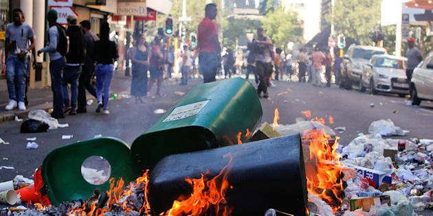 Rubbish burns after students protested outside the parliament during South African Finance Minister Pravin Gordhan's medium term budget speech in Cape Town, South Africa October 26, 2016.