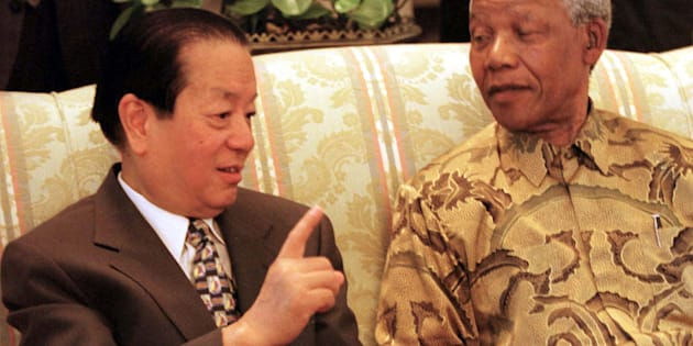 China's Qian Qichen is greeted by President Nelson Mandela at the start of a meeting at Genadendal, Mandela's Cape Town, while Qian was on a five day official visit to South Africa. South Africa have maintained an official presence in Taipei ever since Mandela announced in November 1996 that diplomatic ties with Taipei would be severed in favour of Beijing.