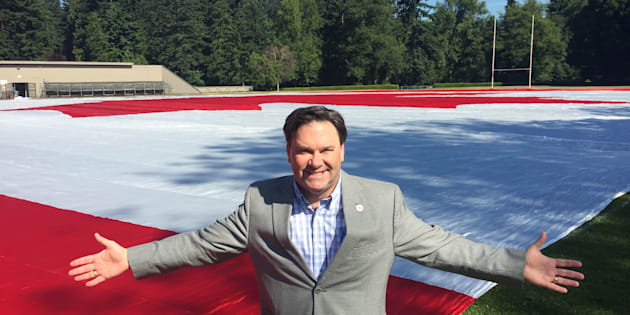 Vancouver area MP Don Davies with a huge Canadian flag made by one of his constituents. The flag is on display in Stanley Park on Canada Day.