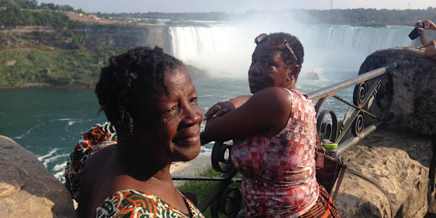 "Maizel Hyde-Sinclair, left, and her sister Nellrene Walker, right, at Niagara Falls. While planning to travel back to her native Jamaica for Maizel's funeral, Nellrene and her son Jared discovered WestJet has a ""discriminatory"" baggage policy."