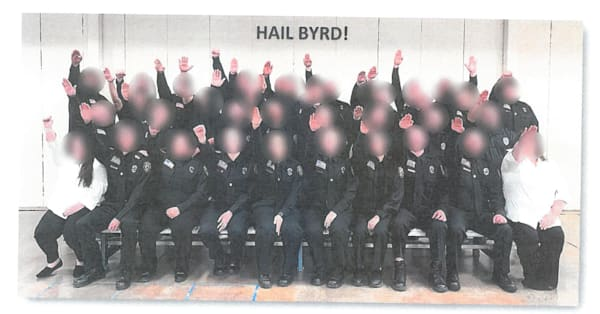 30 corrections officer cadets fired over 'completely unacceptable' gesture during class photo