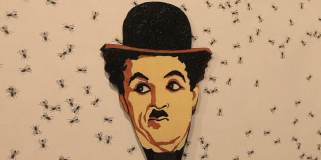 An image of Charlie Chaplin by Russian artist Vasily Slonov seen in the foreground, in Russia's Siberian city of Krasnoyarsk Museum Centre, October 25, 2012.