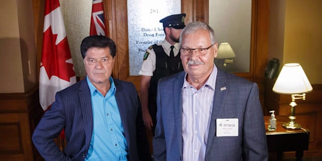 President of Unifor Canada Jerry Dias poses with Ontario Public Service Employees Union president Warren (Smokey) Thomas outside Ontario Premier Doug Ford's office at Queen's Park in Toronto on July 16, 2018.