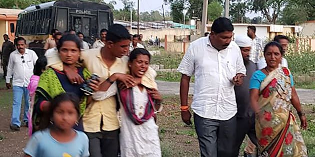 Relatives of those murdered in the Maharastra lynching incident being led away from the crime scene area by villagers in Dhule district.