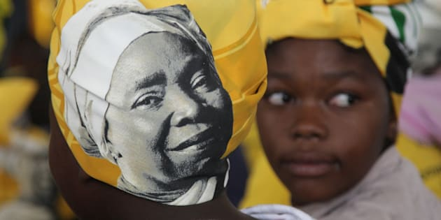A woman is seen wearing a doek adorned with Nkosazana Dlamini-Zumas face during the prayer party organised by the Dlamini Clan in her home Bulwer on December 10, 2017 in KwaZulu-Natal.