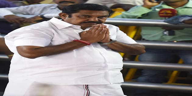 All India Anna Dravida Munnetra Kazhagam (AIADMK) party leader Edappadi Palanisamy gestures as he pays his respects at the memorial for former state chief minister Jayalalithaa Jayaram after being sworn in as the Chief Minister of the state of Tamil Nadu in Chennai on February 16, 2017.