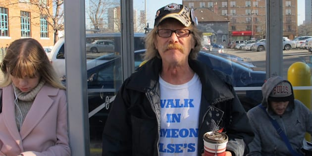 Tim Button poses for a photo while waiting for the bus in Hamilton, Ont. on Nov. 21, 2017. Bus rides are one of the luxuries Button could not afford before enrolling in Ontario's basic income pilot project.