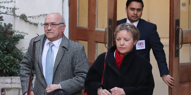 Oxfam's chief executive Mark Goldring (L) and Oxfam's chair of trustees Caroline Thomson leave the Department for International Development (DFID) in central London on February 12, 2018
