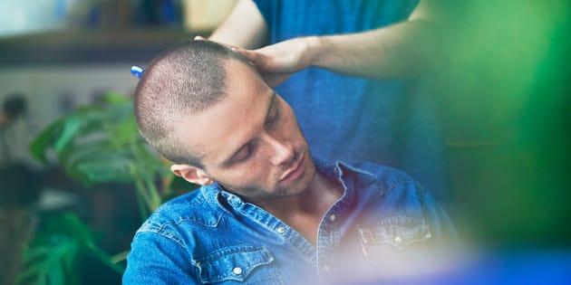 man getting hair cut at barber shop