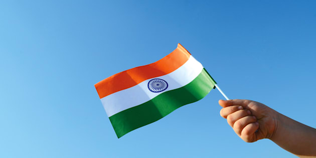 Hand holds the Indian flag on 26th January, India