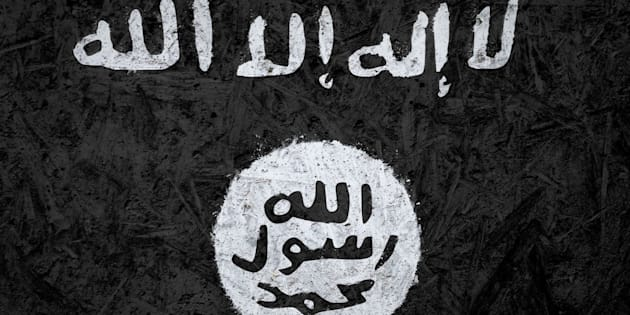 Islamic State of Iraq and the Levant flag on the concrete texture
