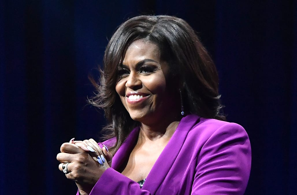 b5a82d33d261b Michelle Obama's purple suit and sequined bustier are a showstopping combo