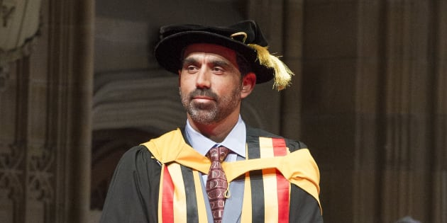 Adam Goodes accepts his honorary doctorate on Thursday