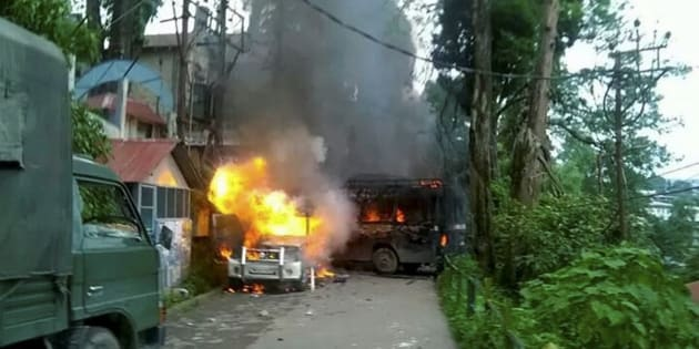 Police Vehicles in flames after being torched  by Gorkha Janmukti Morcha (GJM) supporters in Darjeeling on Thursday.