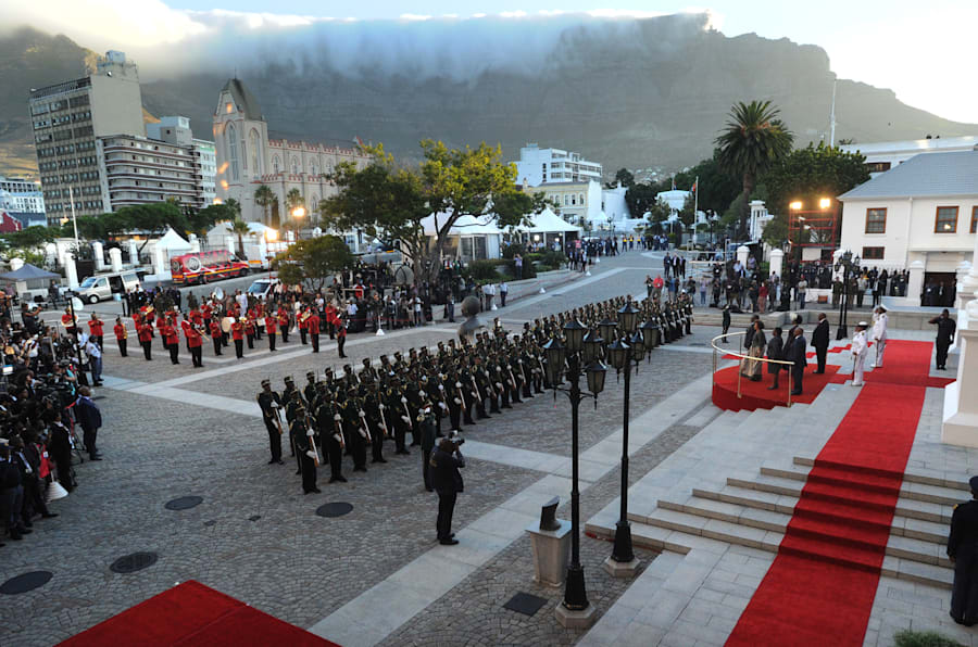 South Africa's newly-minted president Cyril Ramaphosa reviews a guard of honour as he arrives to deliver his State of the National address at the Parliament in Cape Town, on February 16, 2018. The State of the Nation address is an annual mix of political pageantry and policy announcements, but the flagship event was postponed last week as Zuma battled to stay in office. / AFP PHOTO / POOL / Brenton GEACH        (Photo credit should read BRENTON GEACH/AFP/Getty Images)