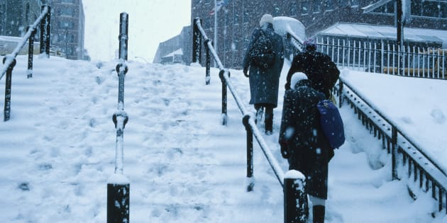 People walking up snowy steps , Nova Scotia , Canada