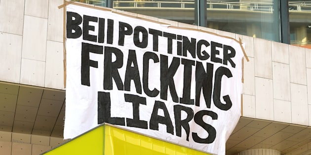 Anti-fracking demonstrators outside the offices of Bell Pottinger in High Holborn in central London, UK.
