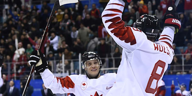 Canada's Wojciech Wolski, right celebrates scoring in the men's bronze medal hockey game. Canada would go on to win the game.