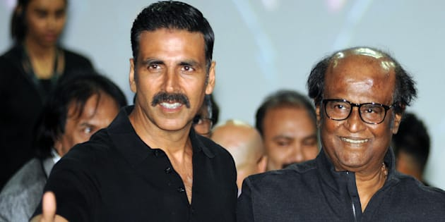 Indian Bollywood actors Akshay Kumar (L) and Rajinikanth pose for a photograph during a promotional event for the forthcoming science fiction Hindi film '2.O' written and directed by S. Shankar in Mumbai on November 20, 2016.
