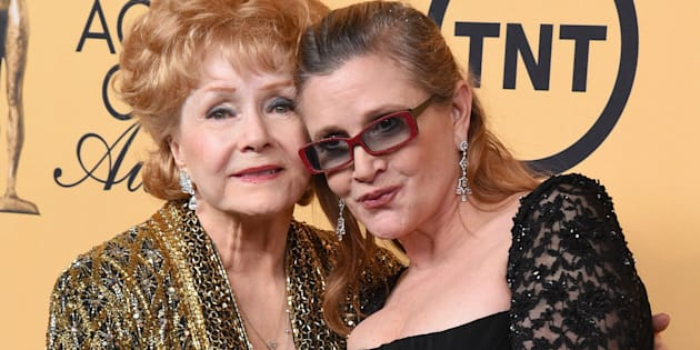 LOS ANGELES, CA - JANUARY 25:  Honoree Debbie Reynolds (L) and actress Carrie Fisher pose in the press room at the 21st Annual Screen Actors Guild Awards at The Shrine Auditorium on January 25, 2015 in Los Angeles, California.  (Photo by Steve Granitz/WireImage)