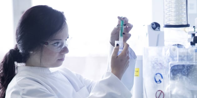 Young female scientist working in a biochemistry labroratory
