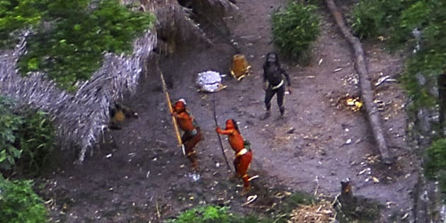 Members of an uncontacted tribe in Brazil's Amazon Basin were photographed by air in 2008. At least 10 members of a tribe in this region were reportedlykilled by gold minerslast month.