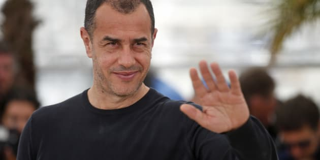 """Director Matteo Garrone gestures as he poses during a photocall for the film """"Tale of Tales"""" in competition at the 68th Cannes Film Festival in Cannes, southern France, May 14, 2015.          REUTERS/Benoit Tessier"""